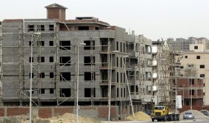 Labourers work at a construction site of residential buildings in El Katameya district of New Cairo